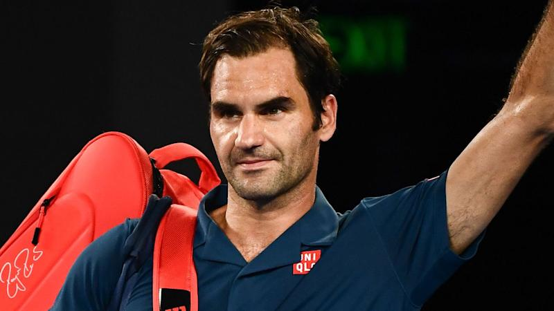 Federer begins ton-up quest with Dubai win