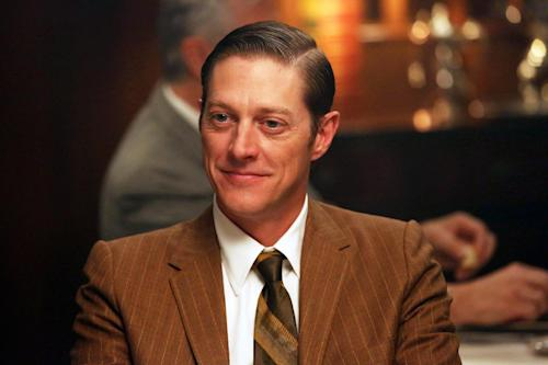 "This undated publicity image released by AMC shows actor Kevin Rahm portraying Ted Chaough in a scene from "" Mad Men."" Rahm's character appeared in a handful episodes in past seasons as the boss of a competing advertising firm. But the recent merger of his and Don Draper's companies _ along with a shocking kiss with Peggy Olson (Elisabeth Moss) _ has thrust Ted to the forefront of the 1960s ad world drama.(AP Photo/AMC, Michael Yarish)"