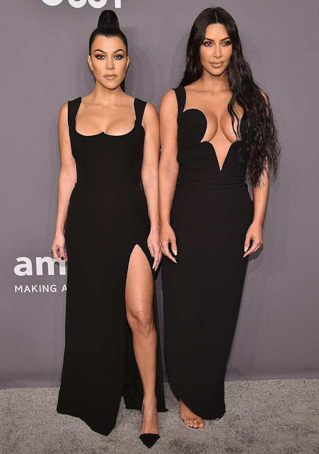 Kim And Kourtney Kardashian Black Dresses at amfAR New York Gala