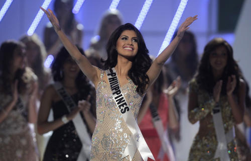 Miss Philippines Shamcey Supsup gestures during the Miss Universe pageant in Sao Paulo, Brazil, Monday, Sept. 12, 2011. Supsup was named third runner up. (AP Photo/Andre Penner)