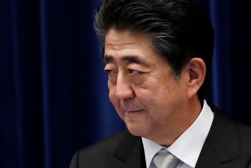 Japan's Prime Minister Shinzo Abe attends a news conference after reshuffling his cabinet at his official residence in Tokyo