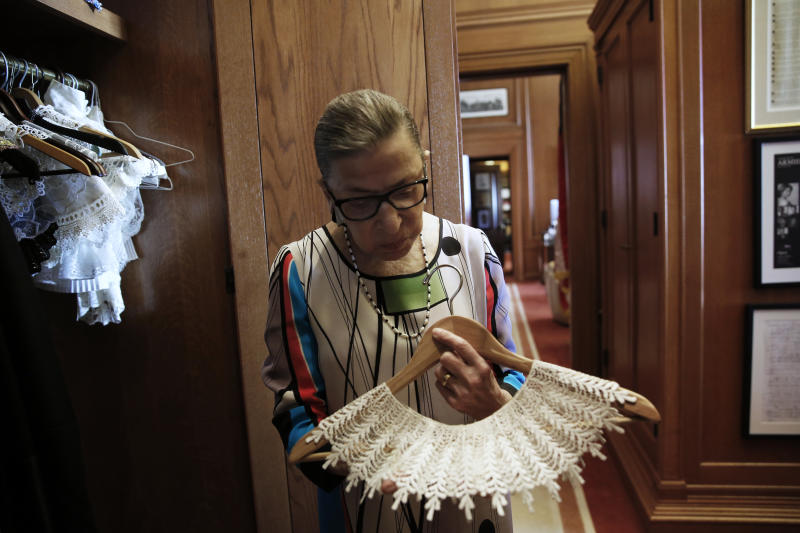 """U.S. Supreme Court Justice Ruth Bader Ginsburg shows the many different collars (jabots) she wears with her robes, in her chambers at the Supreme Court building in Washington, U.S. June 17, 2016. REUTERS/Jonathan Ernst SEARCH """"SCOTUS"""" FOR THIS STORY. THE IMAGES SHOULD ONLY BE USED TOGETHER WITH THE STORY - NO STAND-ALONE USES. IMAGE FOR USE AND PUBLICATION ONLY AS PART OF REUTERS SUPREME COURT """"Marble, drape and justice: inside the U.S. Supreme Court"""" PHOTO ESSAY UNTIL AFTER OCTOBER 1, 2017."""
