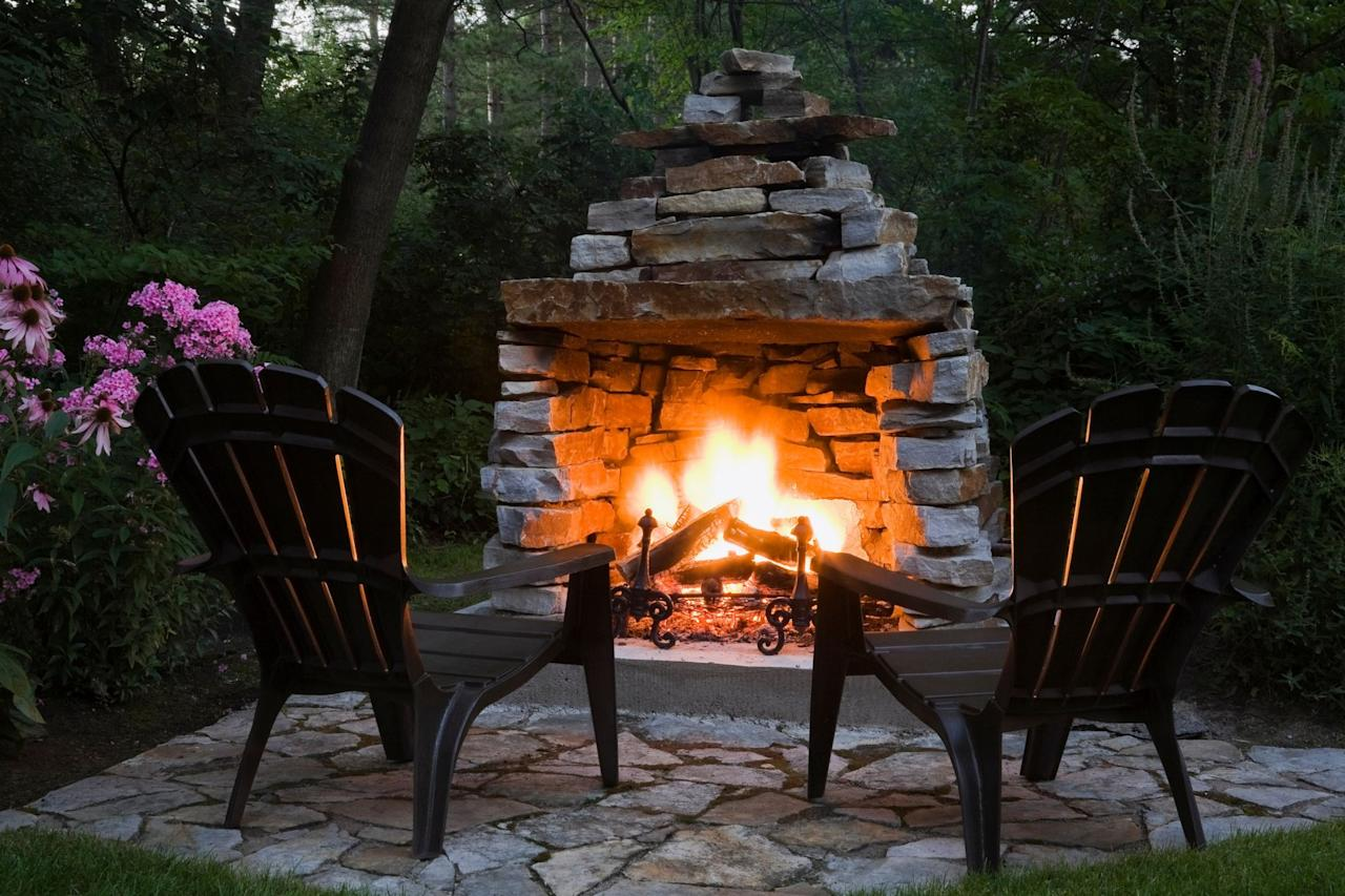 """<p>There's just something so cozy about a fire this time of year—the crackle, the smell, roasting hot dogs, and toasting marshmallows for the <a href=""""https://www.countryliving.com/food-drinks/a28189946/smores-recipe/"""" target=""""_blank"""">best s'mores recipes</a>. Even though campfires get most of the glory, homeowners are embracing the romantic appeal of enjoying a fire in their very own backyards. More and more, when deciding on the <a href=""""https://www.countryliving.com/gardening/garden-ideas/g2314/backyard-ideas/"""" target=""""_blank"""">best ideas for  backyards</a>, an outdoor fireplace or a fire pit is becoming a focal point in the design. And it's no wonder—remember that part about s'mores?</p><p>Whether you have a large, sprawling back lawn space or are looking for <a href=""""https://www.countryliving.com/gardening/news/g4183/small-backyard-ideas/"""" target=""""_blank"""">best ideas for small backyards</a>, an outdoor fireplace or fire pit is something to consider. Custom built-in designs can be on the pricier side, but for smaller budgets, there are plenty of super affordable options for fire pits and chimineas (a great pick for small spaces!) that are just a click away on Amazon. If you're in the mood for a project, try your hand at one of these DIY outdoor fireplace tutorials.</p><p>Either way, you can be relaxing by the glow of an outdoor fire in no time, whether you buy a fire pit for your patio or build an outdoor fireplace from scratch. Now, who's bringing the hot dogs and marshmallows?</p>"""