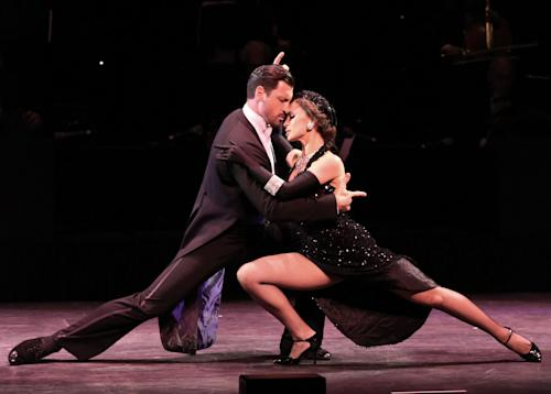 "In this July 11, 2013 photo released by The O + M Company, Maksim Chmerkovskiy, left, and Karina Smirnoff perform during ""Forever Tango"" at the Walter Kerr Theatre in New York. (AP Photo/The O + M Company, Walter McBride)"