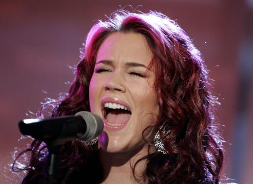 """FILE - In this March 20, 2007 file photo, Joss Stone performs on the NBC """"Today"""" television program in New York. A British jury convicted two men on Wednesday, April 3, 2013 of plotting to rob and kill soul singer Joss Stone. Junior Bradshaw and Kevin Liverpool were arrested in June 2011 close to the singer's house after suspicious neighbors reported them to police. They never reached her house. (AP Photo/Richard Drew, File)"""