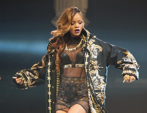 "FILE - This march 18, 2013 file photo shows Rihanna performing on stage during her ""Diamonds"" World Tour at the Air Canada Centre in Toronto. Rihanna has canceled another date on her latest tour because she is ill. Live Nation said that the Grammy-winning singer ""is unable to perform"" at Monday's concert in Houston ""as a result of illness."" The concert promoter said fans ""are instructed to retain their tickets pending rescheduling show date information."" (Photo by Arthur Mola/Invision/AP, file)"