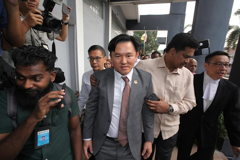 Perak state executive councillor Paul Yong walks to the Sessions Court in Ipoh where he is expected to be charged with rape on August 23, 2019. — Picture by Farhan Najib