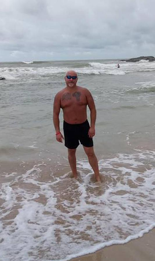 Picture of Andy Citchett on a beach