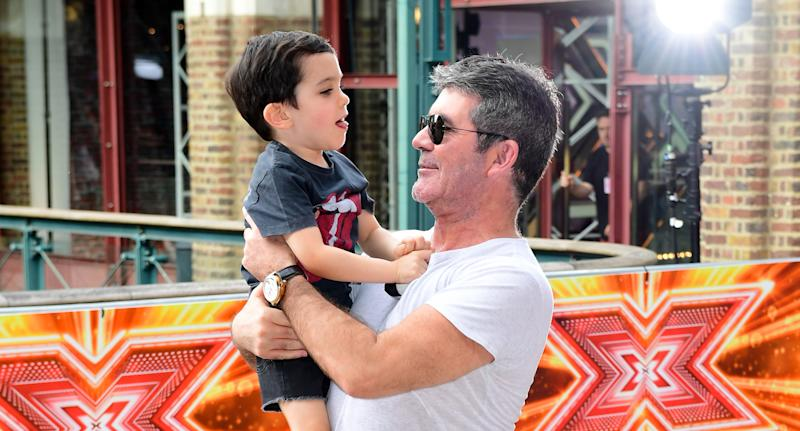 Simon Cowell and son Eric Cowell attending X Factor filming at Tobacco Dock, Wapping Lane, London. (Photo by Ian West/PA Images via Getty Images)