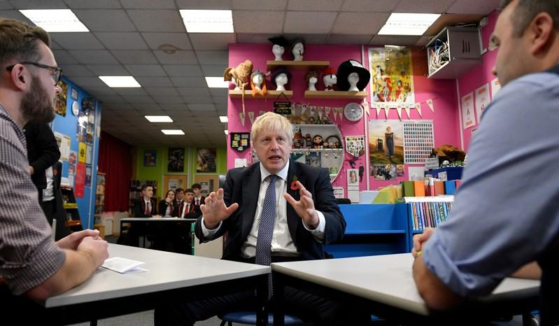FILE PHOTO: Britain's Prime Minister Boris Johnson visits George Spencer Academy during a general election campaign, in Stapleford