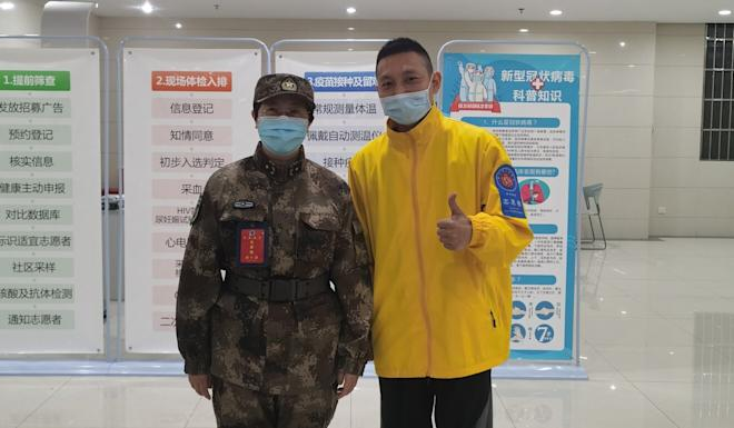 Xiang (right) said team leader Chen Wei (left) told him about the development of the vaccine and assured him he would come to no harm. Photo: Handout