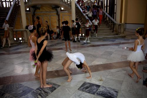 "In this April 3, 2013 photo, ballet students practice before a class at the National School of Ballet in Havana, Cuba. The school was founded seven decades ago by famed prima ballerina assoluta Alicia Alonso, now age 92, who is probably the most recognized person in Cuba not named ""Castro."" (AP Photo/Ramon Espinosa)"