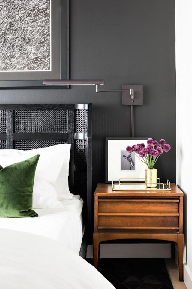 <p>Deep gray doesn't have to be boring. When paired with crisp white accents and wood tones, it can make for a sophisticated look.  </p>