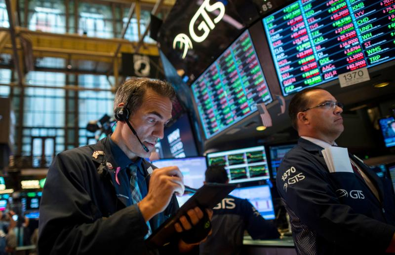 Traders work after the opening bell at the New York Stock Exchange (NYSE) on July 16, 2019, in New York City. - Wall Street stocks edged down from records early Tuesday following mixed banking earnings and worrisome manufacturing data contrasted with strong US retail sales. Shares of JPMorgan Chase, the largest US bank by assets, were slightly negative despite reporting record quarterly earnings as investors focused on the bank's lowered forecast for net interest income in anticipation of Federal Reserve moves to cut interest rates. (Photo by Johannes EISELE / AFP) (Photo credit should read JOHANNES EISELE/AFP/Getty Images)