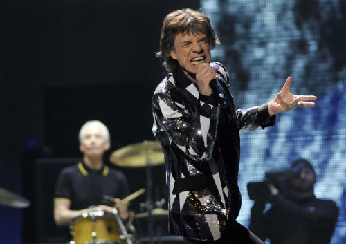 "This May 3, 2013 file photo shows Mick Jagger of the Rolling Stones performing on the kickoff of the band's ""50 and Counting"" tour at the Staples Center in Los Angeles. The Green Valley High School choir in Henderson, Nev., will join the Stones at the MGM Grand Garden Arena in Las Vegas Saturday, May 11, for the encore performance of their hit song, ""You Can't Always Get What You Want.'"" (Photo by Chris Pizzello/Invision/AP)"