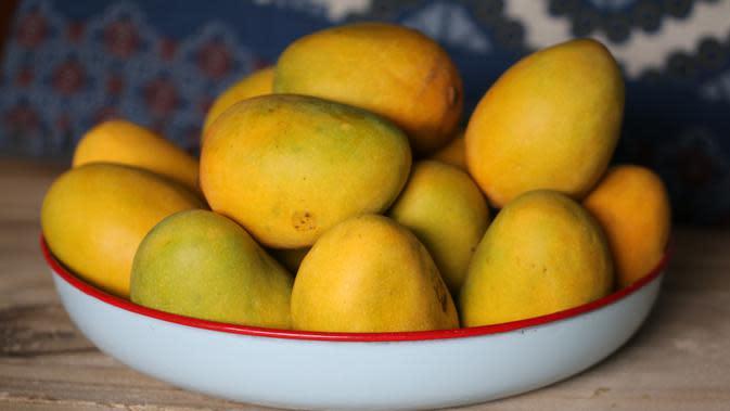 ilustrasi buah mangga/Photo by HOTCHICKSING on Unsplash
