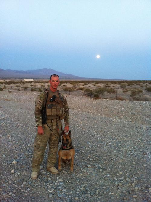"This 2012 publicity photo provided by Animal Planet shows pre-deployment photos of Air Force Tech. Sgt. Leonard Anderson and a bomb-detecting dog, Azza, an 8-year-old Belgian Malinois at training in Las Vegas. After the Nevada training, Air Force Tech. Sgt. Anderson and Azza were sent to Kandahar Province, in Afghanistan. Animal Planet television special ""Glory Hounds,"" included coverage of Air Force Tech. Sgt. Anderson, a military dog handler and his team, when they embedded four camera crews with front line troops for six weeks. (AP Photo/Animal Planet)"
