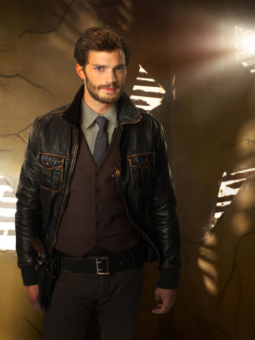 """In this photo released by ABC, Jamie Dornan guest stars as Sheriff Graham on ABC's """"Once Upon a Time."""" """"Fifty Shades of Grey"""" has its male lead, again. Dornan has been cast as Christian Grey, the lead role that Charlie Hunnam withdrew from recently. (AP Photo/ABC, Craig Sjodin/Kharen Hill)"""