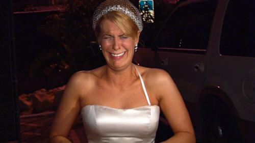 "This image from video released by WE TV shows Kirsten Walker, a bride showcased on the sixth season of the popular wedding series ""Bridezillas."" Walker was a theater actor before hitting the show with enough drama for an Oscar, warring with her band, lamenting that her dress had been cut too short and sobbing on her wedding day. ""Bridezillas"" is ending its decade-long run, having morphed from a relatively sane look at stressed-out, spendy New York brides into a hit for WE tv featuring off-the-hook couples from all walks of life around the country. (AP Photo/WE TV)"