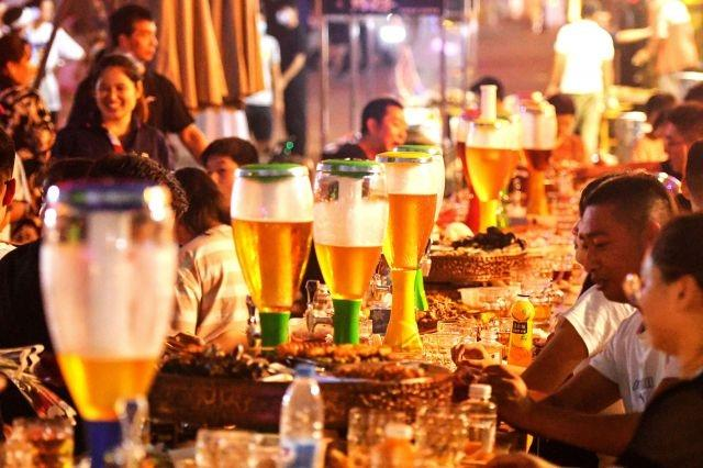 Chinese beer lovers leave facemasks and worries behind as festival opens