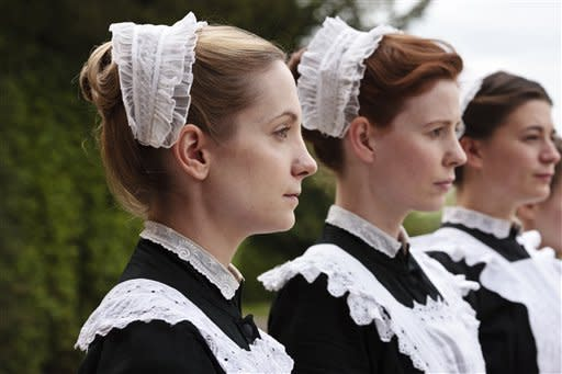 "In this image released by PBS, Joanne Frogatt as Anna Smith, left, and Amy Nuttall as Ethel are shown in a scene from the second season on ""Downton Abbey."" Frogatt was nominated for an Emmy award on Thursday, July 19, 2012 for outstanding supporting actress in a drama series. The 64th annual Primetime Emmy Awards will be presented Sept. 23 at the Nokia Theatre in Los Angeles, hosted by Jimmy Kimmel and airing live on ABC. (AP Photo/PBS, Carnival Film & Television Limited 2011 for MASTERPIECE, Nick Briggs)"
