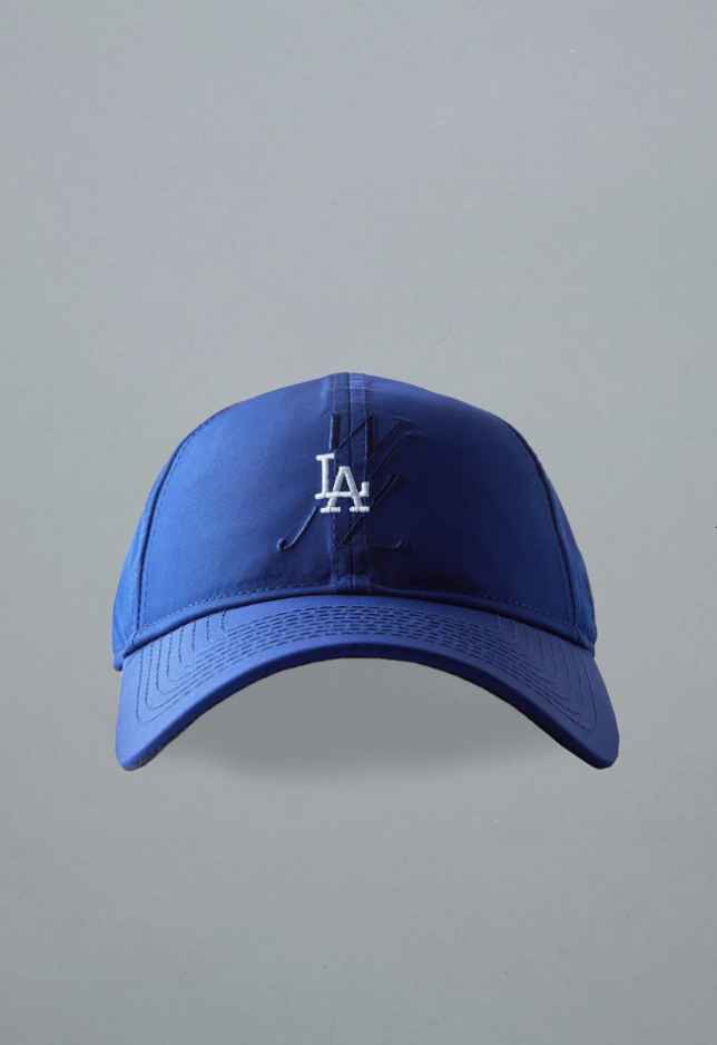 """<p><strong>Public School</strong></p><p>publicschoolnyc.com</p><p><strong>$75.00</strong></p><p><a href=""""https://www.publicschoolnyc.com/psny-x-mlb-dodgers-wnl-dad-hat.html"""" target=""""_blank"""">Shop Now</a></p><p>If he's a sports fanatic, or finds a way to wear baseball hats on every occasion, hit all of the bases with this luxury pick from Public School. Designers Maxwell Osborne and Dao-Yi Chow shook up the industry with their tailored streetwear. </p>"""