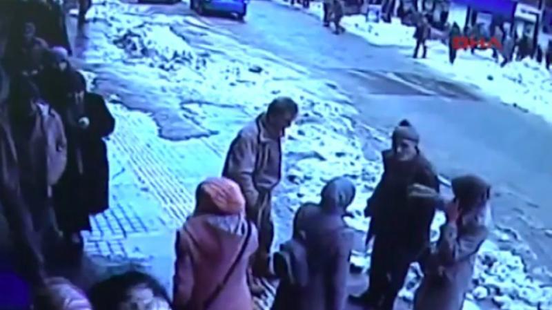 Rooftop avalanche buries pedestrians on busy Turkey street