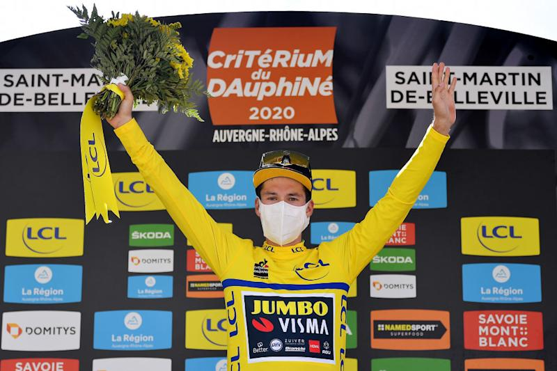 SAINT MARTIN DE BELLEVILLE FRANCE AUGUST 14 Podium Primoz Roglic of Slovenia and Team Jumbo Visma Yellow Leader Jersey Celebration Flowers Covid safety measures during the 72nd Criterium du Dauphine 2020 Stage 3 a 157km stage from Corenc to Saint Martin de Belleville 1419m dauphine Dauphin on August 14 2020 in Saint Martin de Belleville France Photo by Justin SetterfieldGetty Images