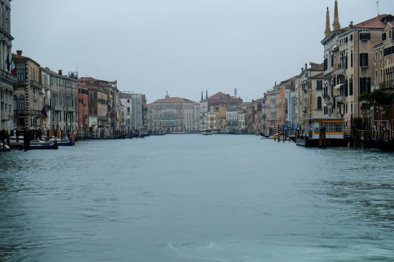 FILE PHOTO: An empty canal is seen after the spread of coronavirus has caused a decline in the number of tourists in Venice