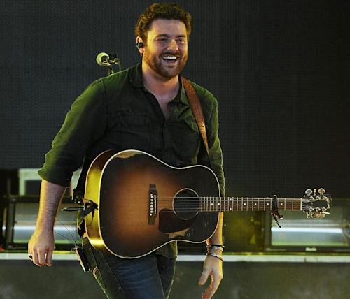 "FILE - In this June 21, 2013 file photo, Chris Young performs during the Beat This Summer Tour at the Cruzan Amphitheater, in West Palm Beach, Fla. Young is holding his new songs from his next album close to his chest, but the one single he has released, ""Aw Naw,"" gives a glimpse of a young country musician that's ready to take his career to the next step. (Photo by Jeff Daly/Invision/AP, File)"
