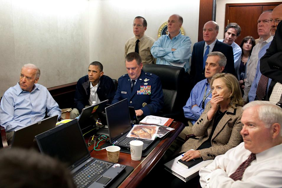 FILE - In this May 1, 2011 image released by the White House and digitally altered by the source to obscure the details of a document on the table, President Barack Obama, second from left, Vice President Joe Biden, left, Secretary of Defense Robert Gates, right, Secretary of State Hillary Rodham Clinton, second right, and members of the national security team watch an update on the mission against Osama bin Laden in the Situation Room of the White House in Washington. The killing of Osama bin Laden, first presented as a moment of national unity by the president, has become something else: a political weapon. Obama's re-election campaign is portraying his risky decision to go after America's top enemy as a defining difference with his Republican presidential opponent, suggesting Mitt Romney might not have had the guts to order a mission that put lives and perhaps a presidency at stake. (AP Photo/The White House, Pete Souza)
