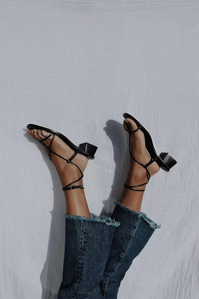 """<p>The lace-up details on these <a href=""""https://www.popsugar.com/buy/FP-Collection-Luna-Mini-Block-Sandals-575398?p_name=FP%20Collection%20Luna%20Mini%20Block%20Sandals&retailer=freepeople.com&pid=575398&price=98&evar1=fab%3Aus&evar9=46281273&evar98=https%3A%2F%2Fwww.popsugar.com%2Ffashion%2Fphoto-gallery%2F46281273%2Fimage%2F47486756%2FFP-Collection-Luna-Mini-Block-Sandals&list1=shopping%2Csandals%2Cshoes%2Cfree%20people%2Csummer%2Csummer%20fashion&prop13=mobile&pdata=1"""" rel=""""nofollow"""" data-shoppable-link=""""1"""" target=""""_blank"""" class=""""ga-track"""" data-ga-category=""""Related"""" data-ga-label=""""https://www.freepeople.com/shop/luna-mini-block-sandals/?category=sandals&amp;color=001&amp;type=REGULAR&amp;quantity=1"""" data-ga-action=""""In-Line Links"""">FP Collection Luna Mini Block Sandals</a> ($98) are so cute.</p>"""