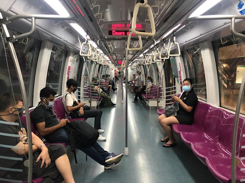 Commuters on an MRT train during COVID-19 enhanced safe distancing period. (PHOTO: Dhany Osman/Yahoo News Singapore)
