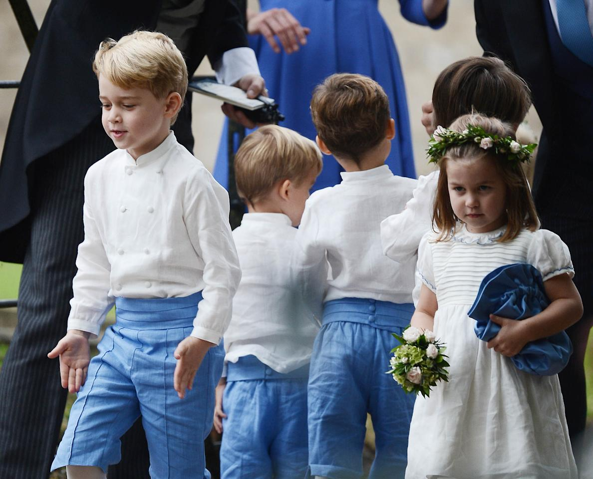 <p>The royal tots were dressed in blue and white as they took on the roles of page boy and flowergirl. Photo: Australscope </p>