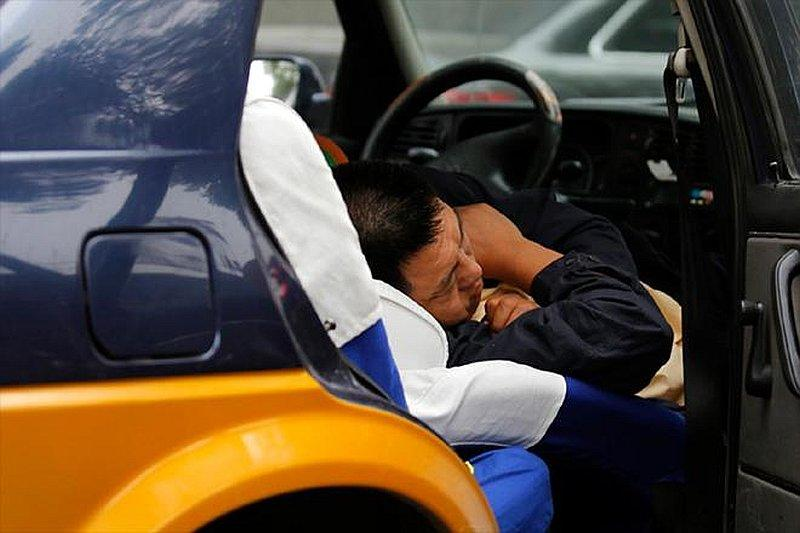 While it may seem pretty comfy to sleep in your car with the AC on, you are actually putting yourself at risk. — Reuters pic