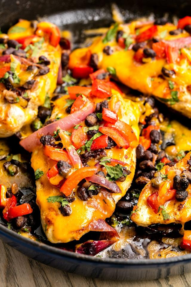 """<p>Tex-Mex at its finest: This skillet chicken is topped with melty cheddar and a delicious black bean-red onion mixture.</p><p>Get the recipe from <a href=""""/cooking/recipe-ideas/recipes/a46562/santa-fe-skillet-chicken-recipe/"""" target=""""_blank"""">Delish</a>.</p><p><a class=""""body-btn-link"""" href=""""https://www.amazon.com/Creuset-Enameled-Cast-Iron-9-Inch-Skillet/dp/B00005QFSP/?tag=syn-yahoo-20&ascsubtag=%5Bartid%7C1782.g.1393%5Bsrc%7Cyahoo-us"""" target=""""_blank"""">BUY NOW</a><strong><em> Le Creuset Cast-Iron 9"""" Skillet, $140, amazon.com</em></strong></p>"""