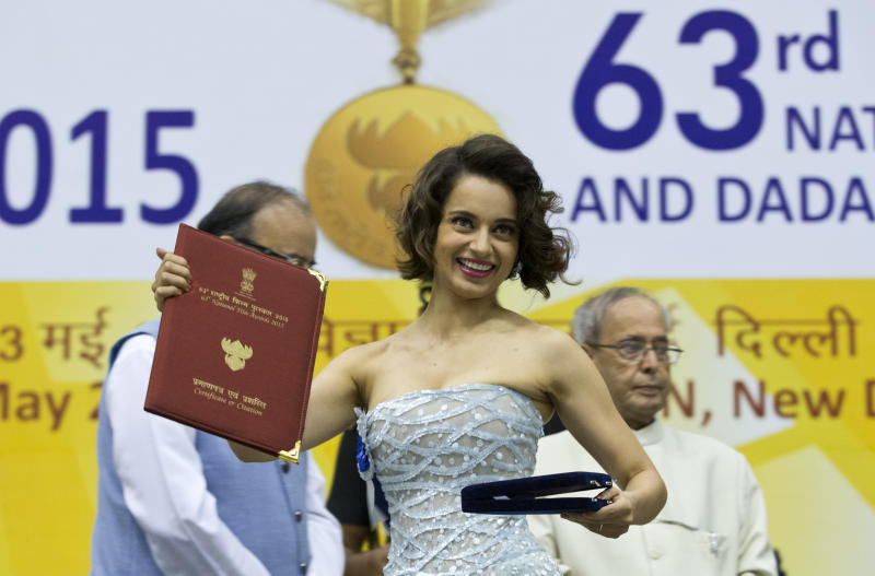 Indian actress Kangana Ranaut shows her national award for best actress after receiving it in India, India, Tuesday, May 3, 2016. Ranaut won the award for her performance in Tanu Weds Manu Returns. (AP Photo/Saurabh Das)