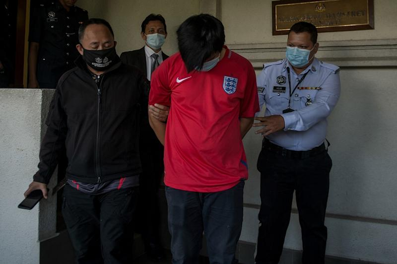 Khor Yong Zhang (centre) is led out of the Magistrate Court in Kuala Lumpur June 1, 2020. — Bernama pic