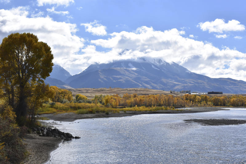 FILE - In this Oct. 8, 2018 file photo, emigrant Peak is seen rising above the Paradise Valley and the Yellowstone River near Emigrant, Mont. Lawmakers have reached bipartisan agreement on an election-year deal to double spending on a popular conservation program and devote nearly $2 billion a year to improve and maintain national parks. (AP Photo/Matthew Brown, File)