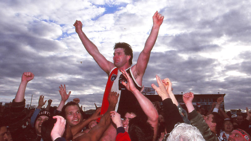 Danny Frawley's family has paid tribute to the father and AFL great (pictured centre) following his tragic death. (Getty Images)
