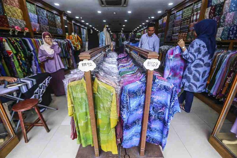 You can find hand-printed batik as well as machine-printed batik shirts in most shops nowadays.