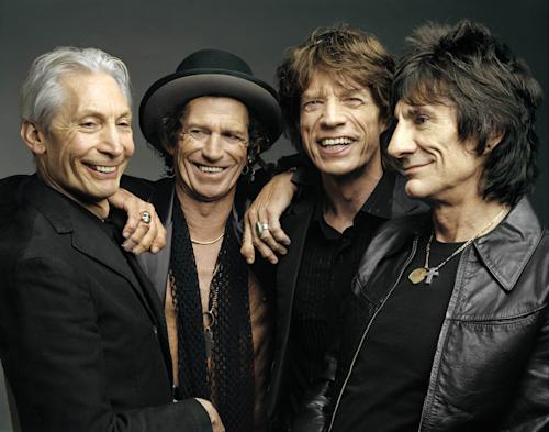 "FILE - This 2005 file photo, originally supplied by the Rolling Stones, shows members of the group, from left, Charlie Watts, Keith Richards, Mick Jagger, and Ron Wood posing during a photo shoot. Rolling Stones memorabilia will be displayed in a new exhibit, ""Rolling Stones 50 Years of Satisfaction,"" at the Rock and Roll Hall of Fame in Cleveland. The exhibit opens on Friday, May 24. (AP Photo/The Rolling Stones, Mark Seliger-File)"