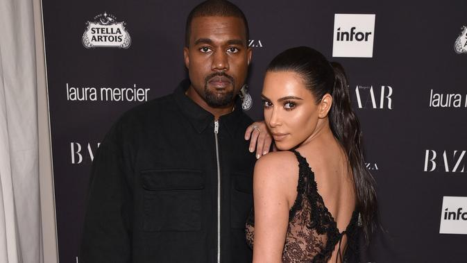 Kim Kardashian dan Kanye West (Bryan Bedder / AFP)