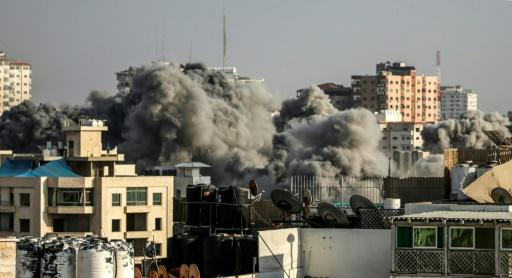 A picture taken on July 14, 2018 shows smoke plumes risisng following an Israeli air strike in Gaza City