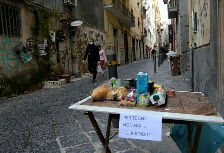 This solidarity table in a street in Naples is for people to leave food for those struggling to afford it