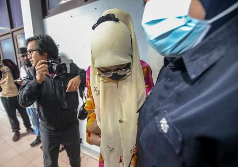 Sergeant (probation) Raja Nur Hasliza Raja Zainal Abidin, 25, arrives at the Ipoh Sessions Court July 13, 2020. — Picture by Farhan Najib