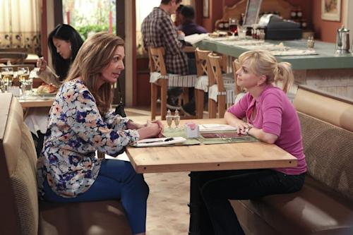 "This publicity image released by CBS shows Anna Faris, right, and Allison Janney in a scene from ""Mom."" The show airs on Mondays on CBS. (AP Photo/CBS, Monty Brinton)"