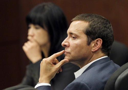 FILE - In an April 7, 2011 file photo, James Arthur Ray, right, and one of his defense attorneys Truc Do, sit in court during his trial. Ray,a self-help author who was convicted of negligent homicide in the deaths of three people following a sweat lodge ceremony he led, was released from the state prison in Buckeye, near Phoenix, on Friday morning July 12, 2013 without speaking to journalists. He had served 85 percent of his two-year sentence for negligent homicide convictions and now is on parole. (AP Photo/Ross D. Franklin, Pool, File)