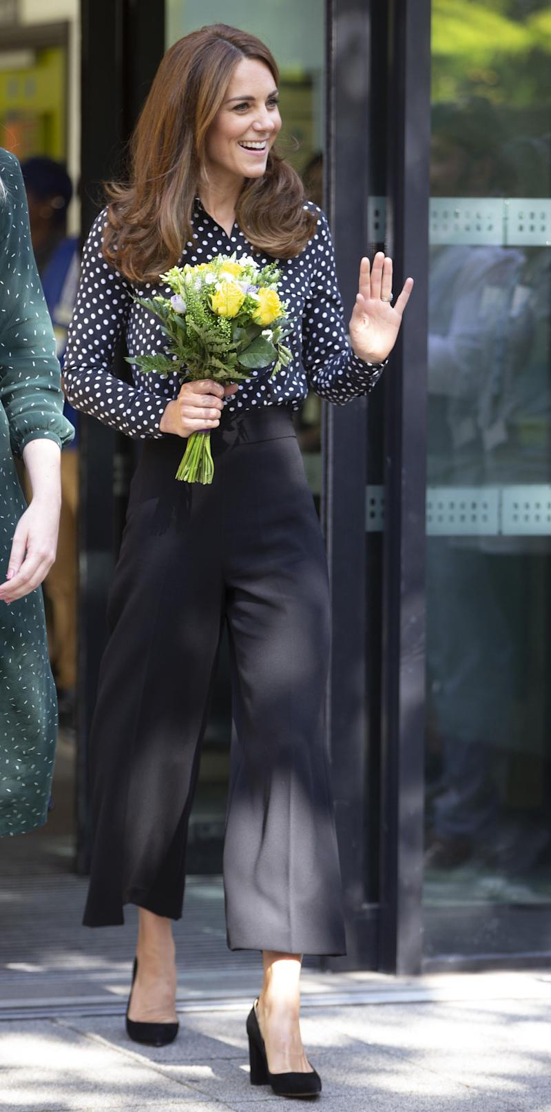 In September last year Kate wore the trousers with a polka dot blouse and heels. (Getty images)