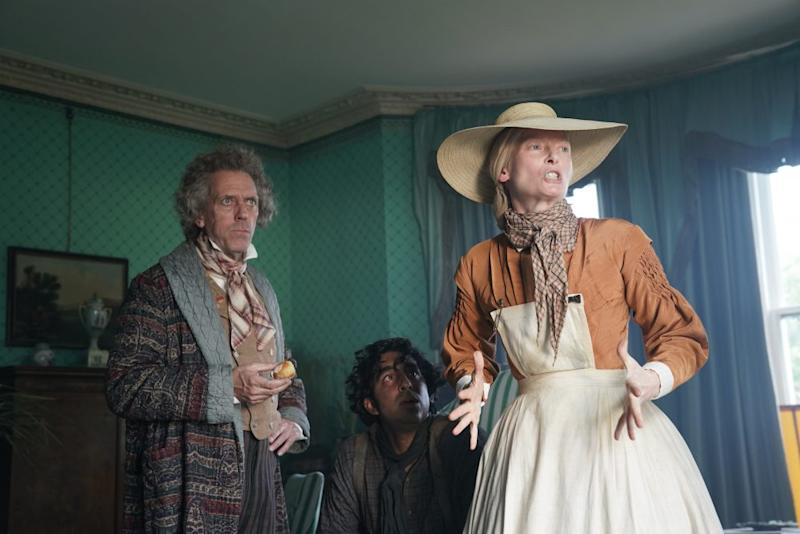 (From L-R): Hugh Laurie, Dev Patel and Tilda Swinton in the film THE PERSONAL HISTORY OF DAVID COPPERFIELD. Photo by Dean Rogers. © 2020 20th Century Studios All Rights Reserved